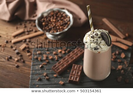 Chocolate and cocoa beans on a straw background Stock photo © galitskaya