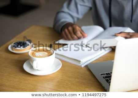 Man Read Book and Drink Coffee in Coffeehouse Stock photo © robuart