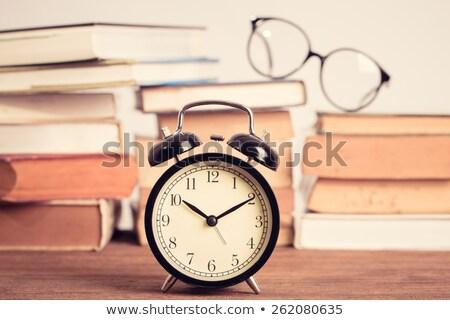 book with alarm clock and eyeglasses  Stock photo © vladacanon