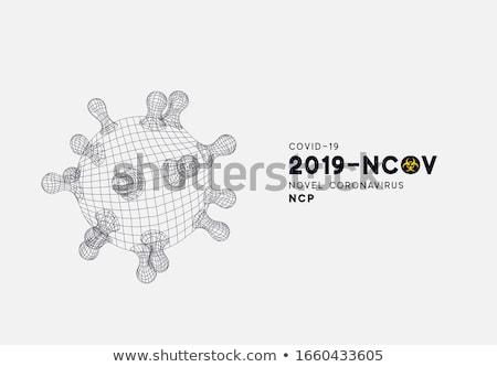 Covid-19. Novel Coronavirus Concept Design with Virus Cell and Biological Danger Symbol on Dark Back Stock photo © articular