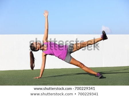 Side plank leg lift fitness woman training body core planking exercise. Workout at outdoor gym or ho Stock photo © Maridav