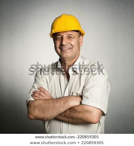 albañil · posando · herramientas · edificio · materiales · azul - foto stock © stockyimages