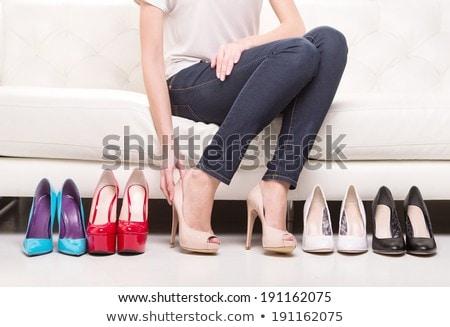 Woman sitting and choosing shoes Stock photo © wavebreak_media