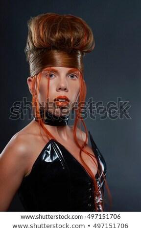 Freaky young female model wearing corset Stock photo © dariazu