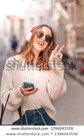 modern trendy young woman making a v sign stock photo © giulio_fornasar