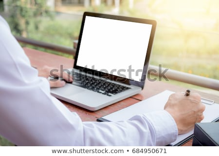 Image of businessman working with laptop, tablet and financial d Stock photo © Freedomz