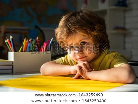 счастливым школьник столе глядя Сток-фото © wavebreak_media