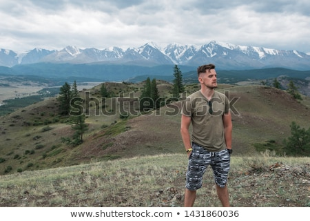 Relaxing man in Kurai steppe on North-Chui ridge Stock photo © olira