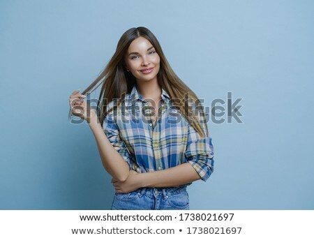 Half length shot of pretty young woman with dark hair, wears stylish clothes, has European appearanc Stock photo © vkstudio