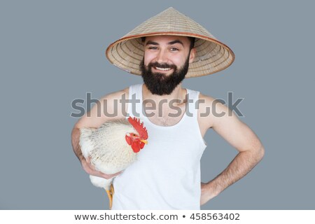 Young man tourist in a traditional Vietnamese hat travels to Vietnam BANNER, LONG FORMAT Stock photo © galitskaya