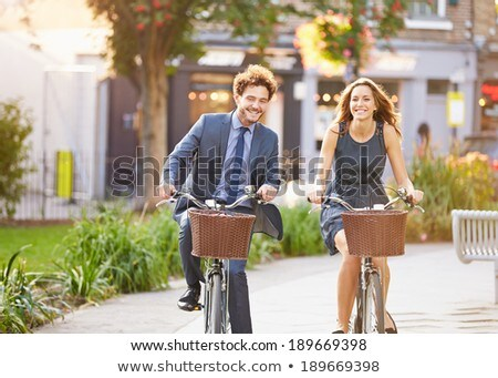 businessman riding bike in the park stock photo © wavebreak_media