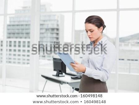 mulher · em · pé · ebook · branco · terno - foto stock © deandrobot