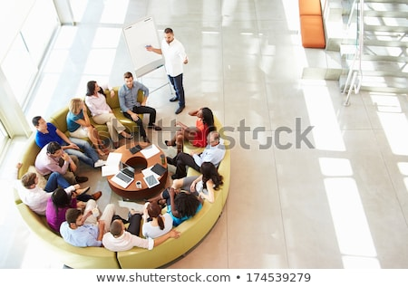 High angle view of multi-ethnic group of business people sitting on chair in lobby at office Stock photo © wavebreak_media