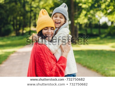 Children dressed in warm autumn clothes hug and smile in the red and yellow forest Stock photo © ElenaBatkova