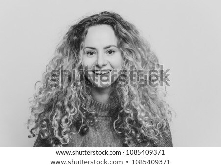 Isolated shot of attractive glad blonde gorgeous female has curly hair, has broad smile, being in hi Stock photo © vkstudio