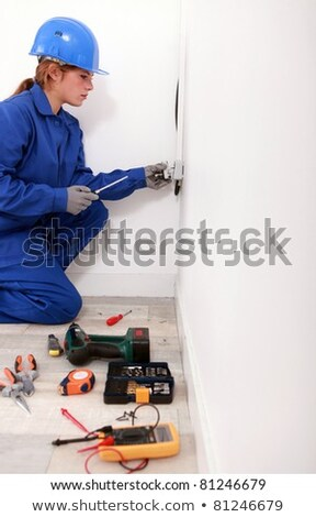 female electrician wiring a white room stock photo © photography33
