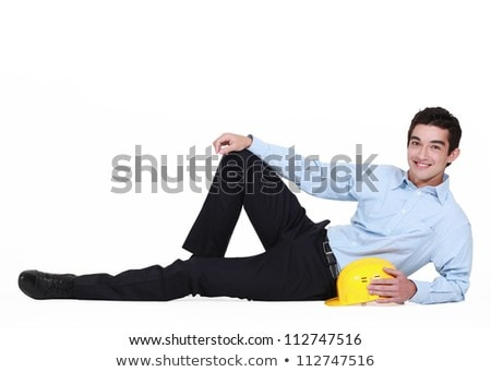 portrait of young foreman lying on floor with hard hat Stock photo © photography33