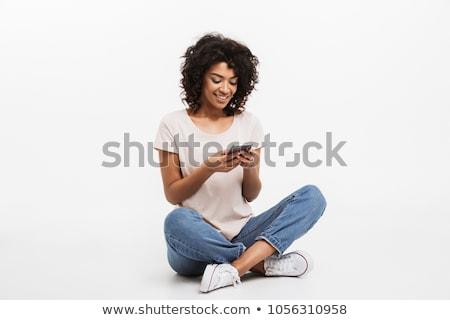 mosolygó · nő · beszél · telefon · fehér · háttér · kommunikáció - stock fotó © wavebreak_media