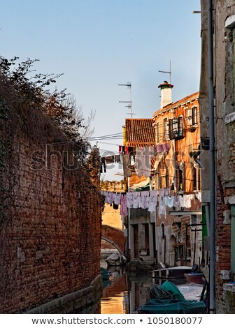 Stock photo: small historic channels in Venice with cloths to dry