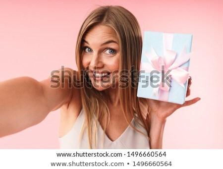 Blond alluring girl holding the gifts Stock photo © konradbak