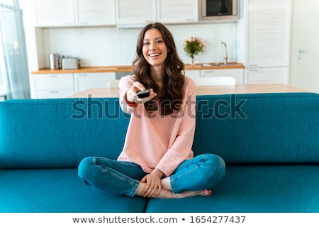 Young woman with remote control Stock photo © boggy
