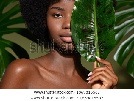 Woman with beautiful make-up against background Stock photo © Elnur