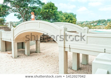 Woman standing on arched bridge at Balmoral Beach Stock photo © lovleah
