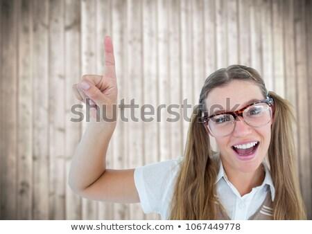 Stréber nő mutat felfelé homályos fa Stock fotó © wavebreak_media