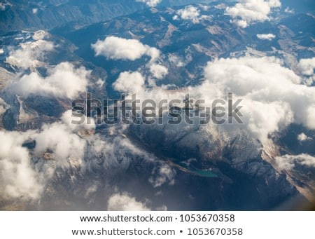 Dolomites Alps - Italy Mountains Under Clouds. View from Airplan Stock photo © ShustrikS
