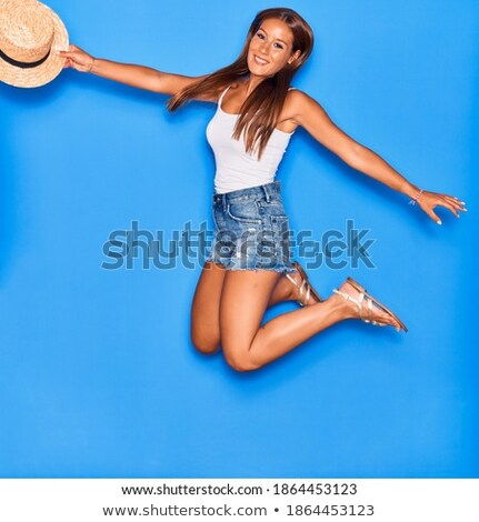 Stock photo: Woman with arms in the air