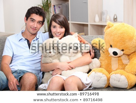 Couple sat on couch with cuddly toys Stock photo © photography33