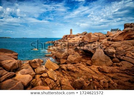 Rosa granito costa praia água nuvens Foto stock © smuki