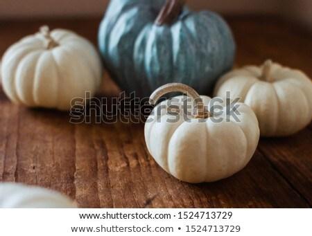 pumpkins on wooden table stock photo © choreograph