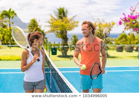 Tennis players friends having fun laughing playing on outdoor court. Couple or mixed double tennis p Stock photo © Maridav
