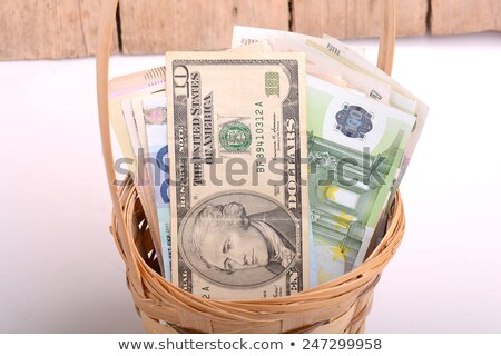 money set in a basket dollars euro and ukrainian money stock photo © fotoscool