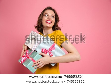 pretty woman holding a bunch of gift boxes stock photo © konradbak