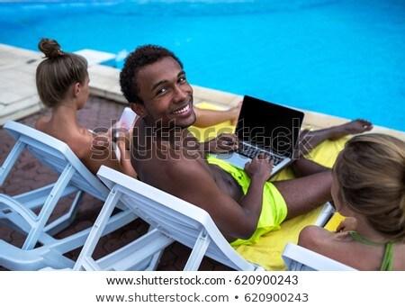 Hátsó nézet fiatal afroamerikai nő ül udvar Stock fotó © wavebreak_media
