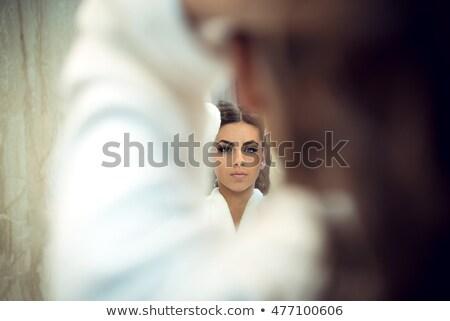 Esmer kız beyaz bornoz ayakta ayna Stok fotoğraf © pressmaster