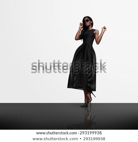 Brunette zwarte lang jurk elegante Stockfoto © zdenkam