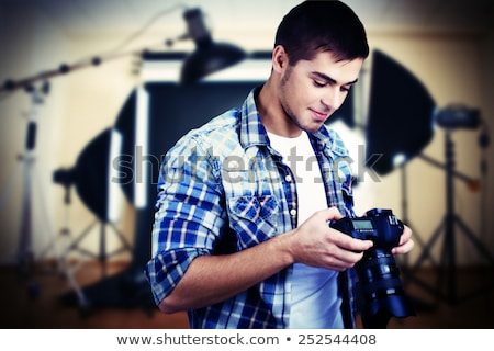 Smiling Photographer with Professional Equipment Stock photo © robuart