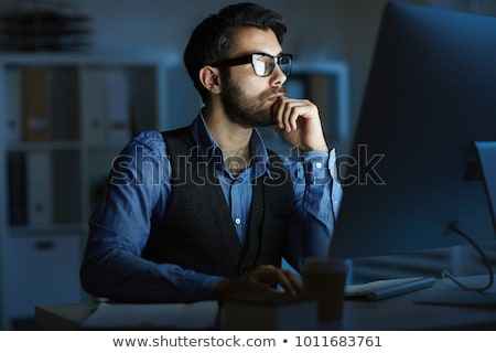 Concentrating in front of monitor stock photo © pressmaster