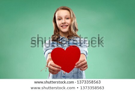 girl with red heart over green school chalk board Stock photo © dolgachov