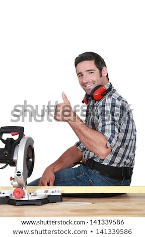 Approving tradesman using a mitre saw Stock photo © photography33