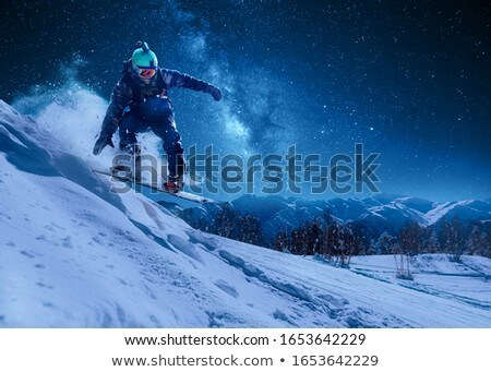 man with snowboard on top of mountain stock photo © is2