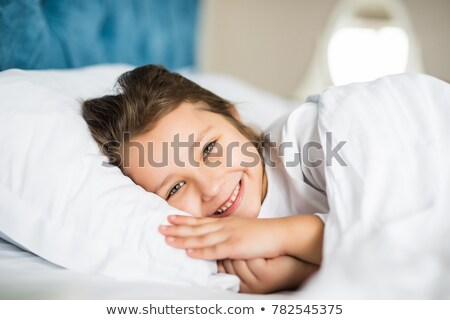 Adorable little girl wake up in her bed Stock photo © Lopolo