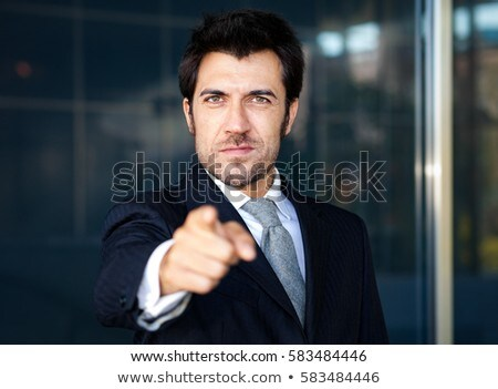 優しい ビジネスマン ポインティング 指 ビジネス お金 ストックフォト © Minervastock