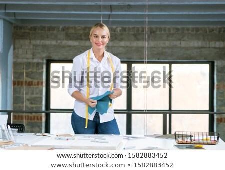 Güzel genç yaratıcı tasarımcı bakıyor ayakta Stok fotoğraf © pressmaster