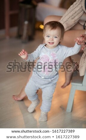 Close up of a 2-3 year old girl who takes her first steps Stock photo © ElenaBatkova