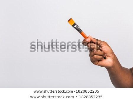 Decorator holding paintbrush Stock photo © photography33