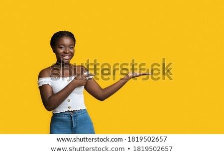 örömteli · tini · nő · bemutat · valami · fehér - stock fotó © dolgachov